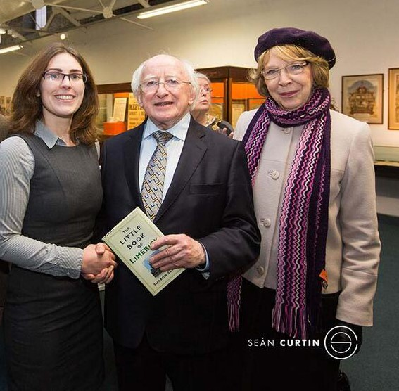 PRESIDENT OF IRELAND MICHAEL D HIGGINS RECEIVING A COPY OF THE LITTLE BOOK OF LIMERICK, 2014. Image by Sean Curtin
